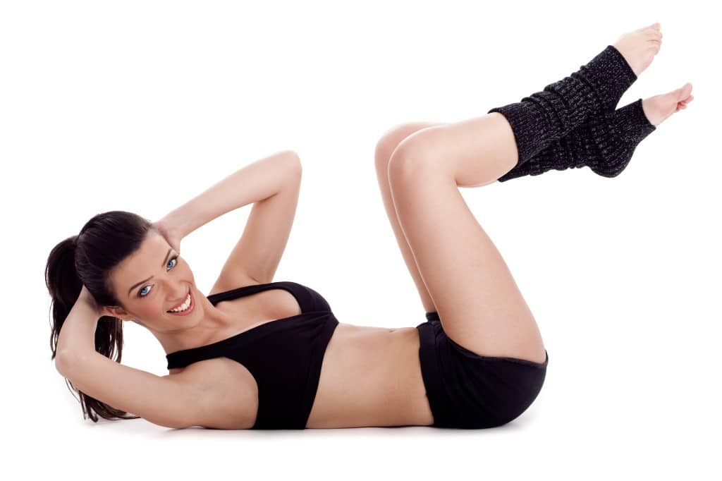 Fitness instructor doing situp exercise and turning to camera